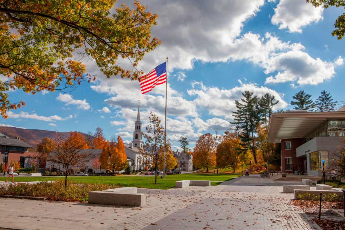Paresky lawn in the fall with an American flag flying in the center.